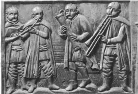 Cantor, corneta, flauta baja y sacabuche (Bajorelieve polaco, S. XV